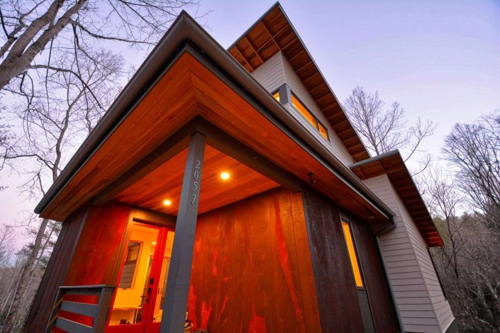 small modern asheville W2 architects Jade Mountain home steel rust siding